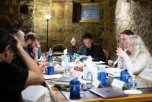 Members of the Crescas Workshop discuss over lunch